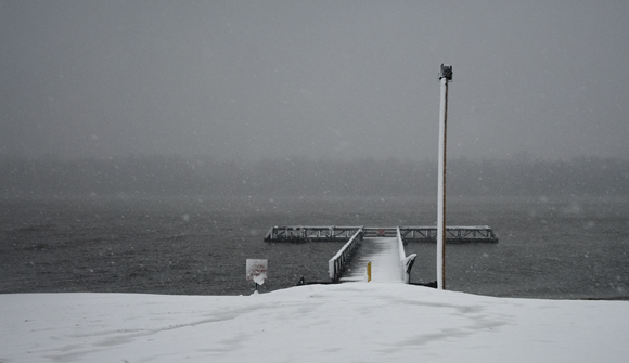 fishing pier in snow storm